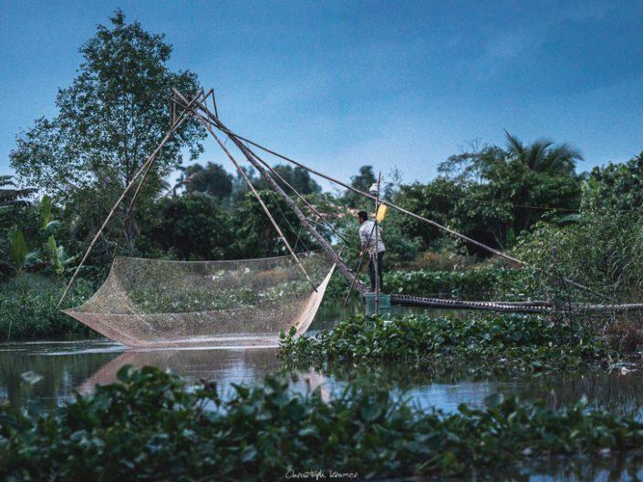 Fischer im Mekong Delta